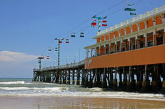 Oceanside pier with chair lift Royalty Free Stock Photography