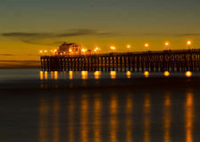Oceanside Pier at sunset. Sunset at Oceanside California pier showing the resturant at the end of the pier Stock Images