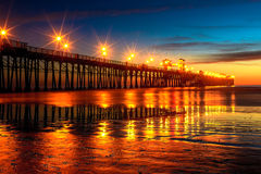 Oceanside Pier after Sunset. This image of a pier was captured in Oceanside, California not too long after sunset.  The pier lights make nice reflections and the Royalty Free Stock Photos