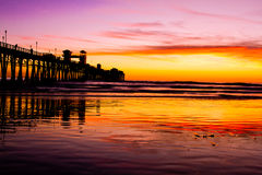 Oceanside Pier at Sunset. This photograph is of the Oceanside, California pier at sunset.  A few clouds created some nice colors and reflections Royalty Free Stock Image