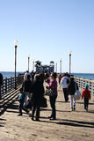Oceanside Pier. Oceanside, United States - December 25, 2015: Visitors and Tourists walk in fine weather over the Oceanside Pier on December 25, 2015 in Royalty Free Stock Photos