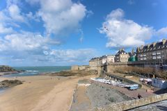 Oceanside scene sunny day clouds beach and birds in Saint-Malo France stock photography