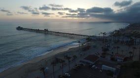 Oceansidepir på solnedgången lager videofilmer