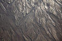 Oceany Tworzący wzory w piasku obraz stock