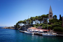 Ocen view and blue sky in Veli Losinj island in Croatia. Ocean view and catholic church tower in Veli Losinj island in Croatia Royalty Free Stock Photography