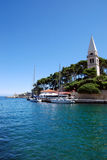Ocen view and blue sky in Veli Losinj island in Croatia. Ocean view and catholic church tower in Veli Losinj island in Croatia Stock Image
