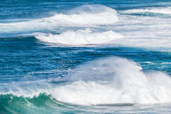 Ocen waves. Blue ocean water with white waves in late afternoon royalty free stock photography