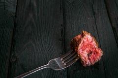 Och ett stycke av stekt kött Arkivbilder