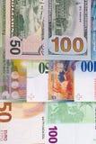 100 och 50 eurodollar, schweizisk francbakgrund Arkivfoton