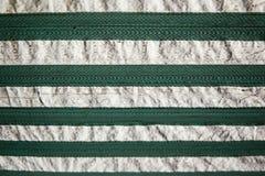 Och vita band för bakgrund, för gräsplan för textur, arkivbild