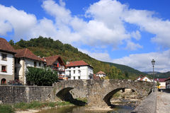 Ochagavia (Navarra, Spain). Typical houses, medieval stone bridge and river in Ochagavia, a little village in the north spanish mountains. Sunny day Royalty Free Stock Image