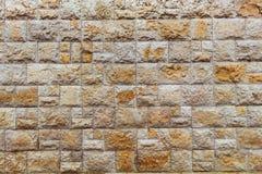 Ocher покрашенная предпосылка камней стоковая фотография