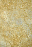 Ocher crackle. Close up cracked ocher weathered wall background rome italy Royalty Free Stock Photos