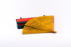 Ocher decorated fan and a red - green box Royalty Free Stock Images