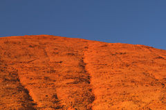 Ocher hill and blue sky. Royalty Free Stock Image
