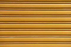 Ocher roller shutters Royalty Free Stock Photos
