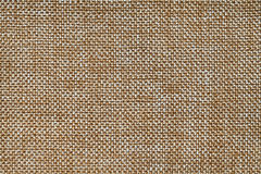 Ocher textile background closeup. Structure of the fabric macro Royalty Free Stock Image