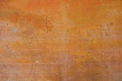 Ocher wall with damage. Royalty Free Stock Photos