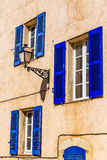 Ocher Wall,Lamp And Blue Window-Provemnce,France Royalty Free Stock Image