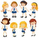 Ocho colegialas en sus uniformes Fotografía de archivo