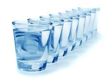 Ocho vidrios de agua Foto de archivo