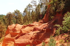 Ochre colored rocks near French Roussillon Stock Photography