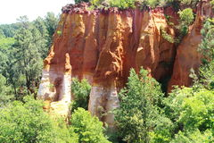 Ochre colored rocks near French village of Roussillon Royalty Free Stock Photography