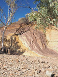 Ochre lines in the banks of a creek. At midday in the McDonnell Ranges, place of indigenous Ochre mining, Alice Springs, Australia, July 2015 Royalty Free Stock Image
