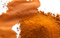 Ochre, a natural earth pigment. Ochre, also spelled ocher, a natural yellow earth pigment based on hydrated iron oxide Royalty Free Stock Photography