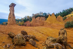 Ochre rock formations in French Colorado, Provence, France Royalty Free Stock Photo