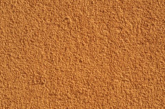 Ochre stucco wall Stock Image