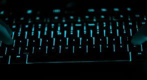 Ochrona - tekst na iluminującej komputerowej klawiaturze przy nocą zdjęcie stock