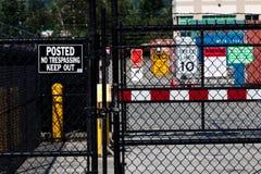 Ochrony brama z różnorodnymi ostrożności i dopuszczenia znakami obrazy royalty free