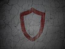 Ochrony pojęcie: Obrysowywająca osłona na grunge ścianie Obrazy Stock