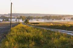 Ochtend in het platteland, gebiedsweg stock afbeeldingen