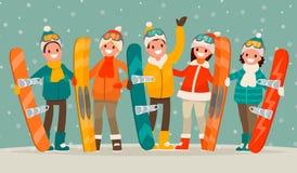 Ocio del active del invierno Un grupo de personas con las snowboard y SK Imagen de archivo libre de regalías