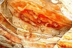 Ockerhaltige Höhlen-Handmalerei lizenzfreies stockfoto