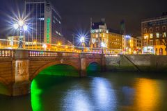 OConnell bridge in Dublin at night. DUBLIN, IRELAND - FEBRUARY 20, 2012: OConnell bridge in Dublin at night, Ireland. Dublin is the capital and largest city of Stock Image