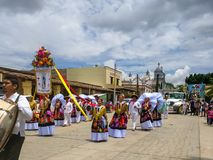Honorary Delegation Parade. OCOTLAN DE MORELOS, OAXACA, MEX.-July 24, 2017. Guelaguetza. Members of a special delegation parade through the streets with an Royalty Free Stock Photos