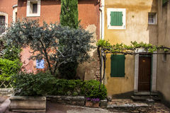 Ocra Old façade door Provence plants Royalty Free Stock Images