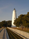 Ocracoke Lighthouse. Boardwalk leading to Ocracoke Lighthouse in the Outer Banks, NC. Oblique lines in fence move viewer into the picture Stock Photos