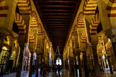 Oct 2018 - Cordoba, Spain - The famous arched interiors of Mezquita, Catedral de Cordoba. A former Moorish Mosque that is now the Cathedral of Cordoba royalty free stock images