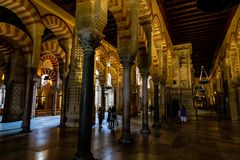Oct 2018 - Cordoba, Spain - The famous arched interiors of Mezquita, Catedral de Cordoba. A former Moorish Mosque that is now the Cathedral of Cordoba stock image