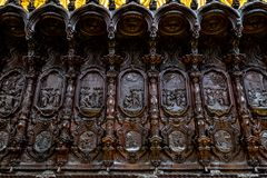 Oct 2018 - Cordoba, Spain - The wooden carved seats of the choir of Mezquita, Catedral de Cordoba. A former Moorish Mosque that is now the Cathedral of Cordoba stock images