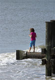 Oct 8, 2015: Girl standing above an Atlantic Ocean beach. Stock Photography