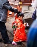 Little girl in Kimono dress at Japanese shrine Royalty Free Stock Photo