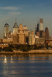 OCT 15, 2016, Philadelphia, PA skyscrappers and skyline at sunrise reflect golden light in Delaware River, as seen from Camden, NJ Royalty Free Stock Image