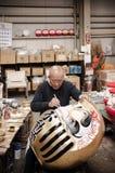 Man making Daruma in Daruma workshop stock photography