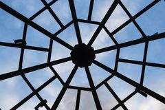 Octagon grille. Metal lattice in the form of an octagon. Silhouette on blue sky background Royalty Free Stock Images