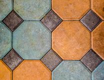 Octagon paving stones. Background  orange and green octagon paving stones Stock Images